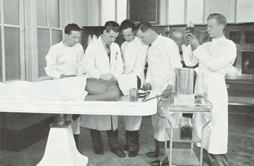 photo of students inspecting a cadaver on a gurney | Worsham College of Mortuary Science