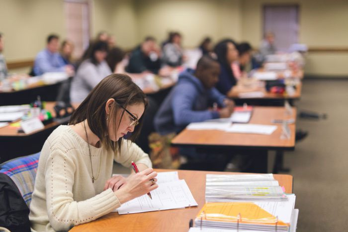 Students takes notes in class preparing for apprenticeship